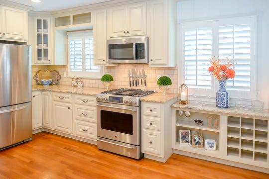 The kitchen has stainless steel appliances and features a lot of storage.