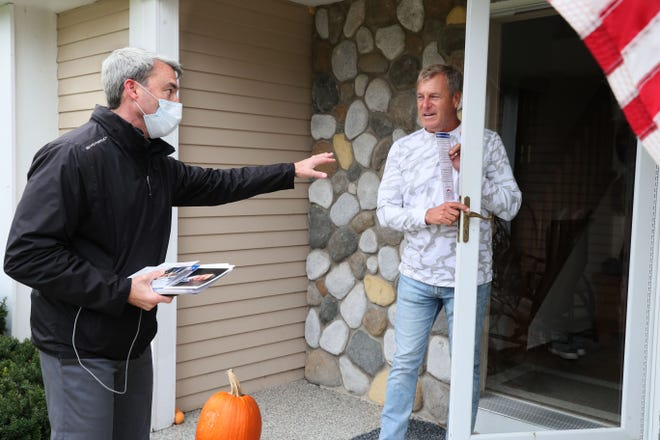 Rob Hutton goes door to door campaigning for 13th Assembly District in a Brookfield neighborhood off Calhoun Road and Bluemound Road.  Here he talks with Bob Moore (right) of Brookfield at Moore's home.