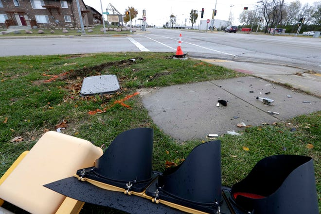 "A downed traffic light pole and markers at North 76th Street and West Calumet Road show where a 7-year-old girl died and her mother was injured after a hit-and-run crash in Milwaukee Wednesday night. The girl and her mother were hit by a ""reckless vehicle traveling at high speeds,"" police said. The vehicle fled the scene."