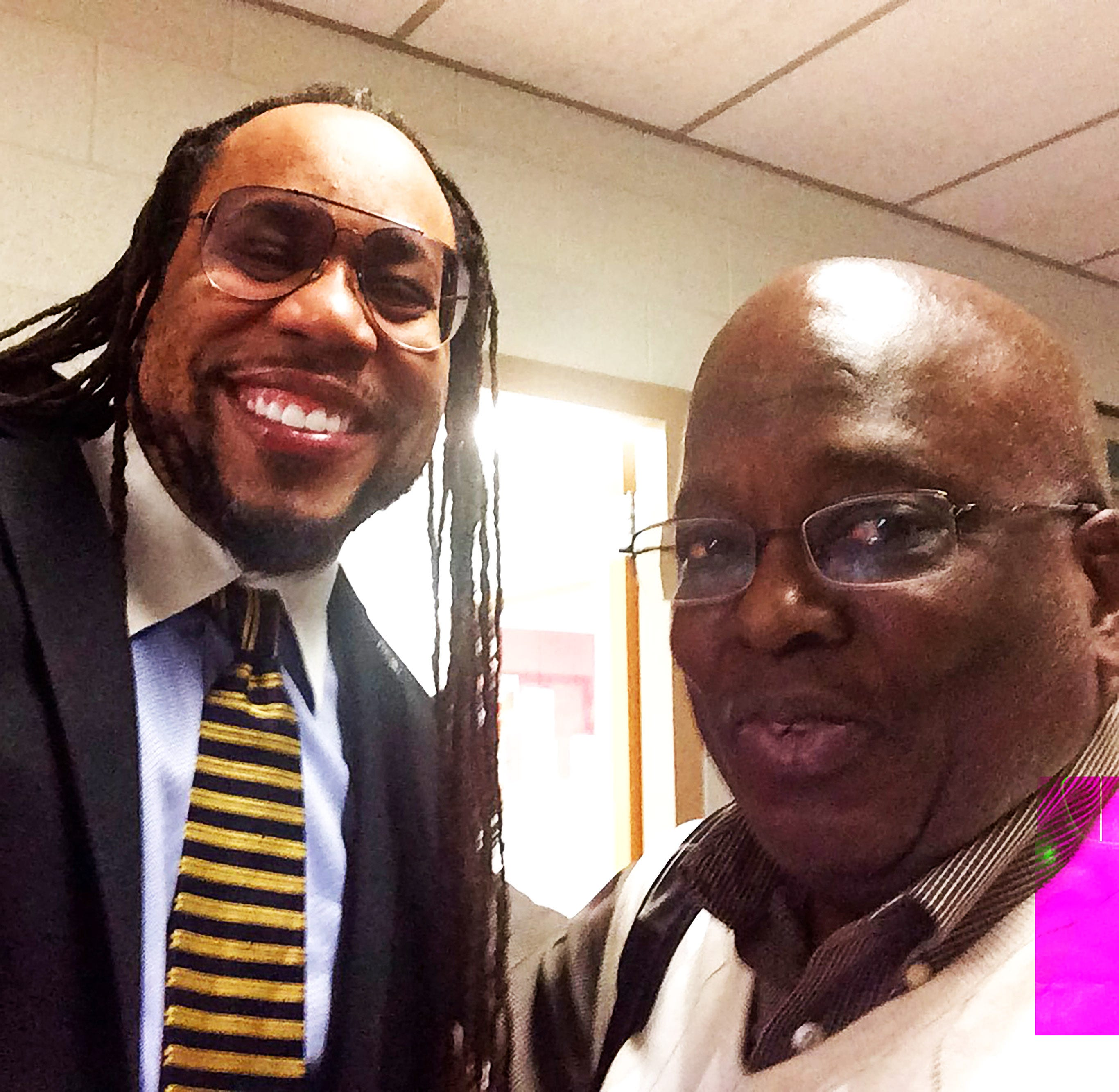 Reporter James E. Causey with Ron Jackson, his first and only African American male teacher. Jackson taught Spanish at John Marshall High School.