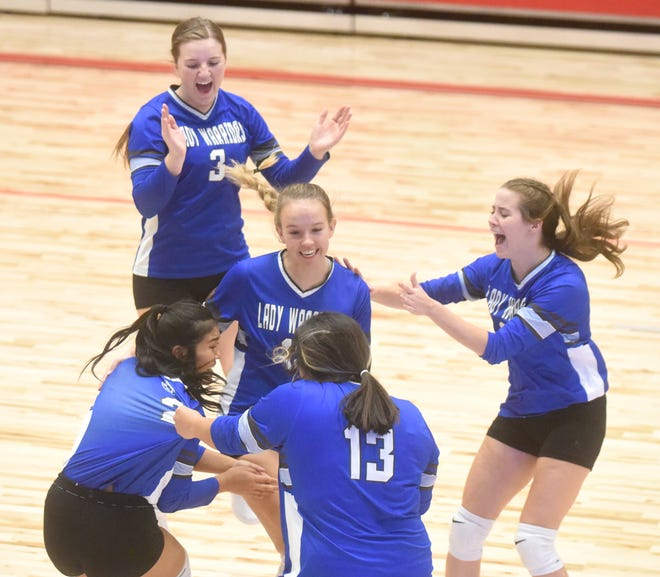 Cotter players Mai Tathong, Hailey Cordell, Tylar Coots, Ashley Garay and Candace Lambert celebrate their victory in the Class 2A State quarterfinals on Wednesday.