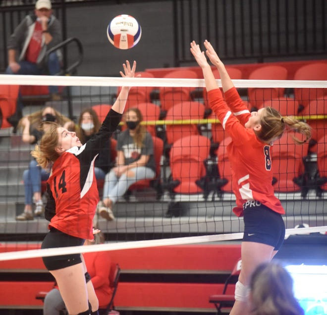 Flippin's Kaylee Warren tips over a Mansfield blocker on Wednesday at the Class 2A State tournament.