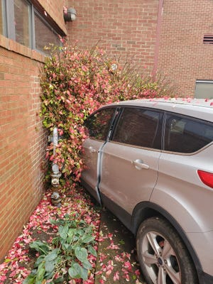 Officials are evaluating damage after a vehicle crashed into Newark Fire Station 3 on West Main Street on Wednesday, Oct. 28, 2020.