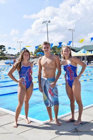 Pace swimmers (L to R) Landry Hadder, Jack Rowell and Emma Wortman, each school-recorders and regional champions, pose for a photo leading up to the 2020 FHSAA state championships.