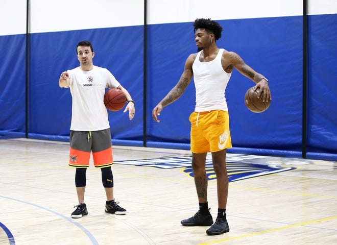 Oct 19, 2020; Peoria, Arizona, USA; Coach Kyle Weaver (left) works with Terry Armstrong during a pre-NBA draft skills training workout at Dream City Christian School. Mandatory Credit: Rob Schumacher/The Arizona Republic via USA TODAY NETWORK