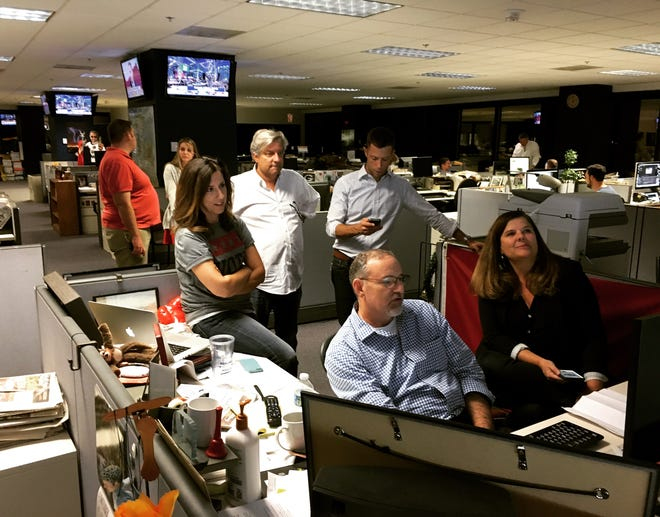 Members of The Arizona Republic newsroom watch late-night returns during the 2016 presidential election.