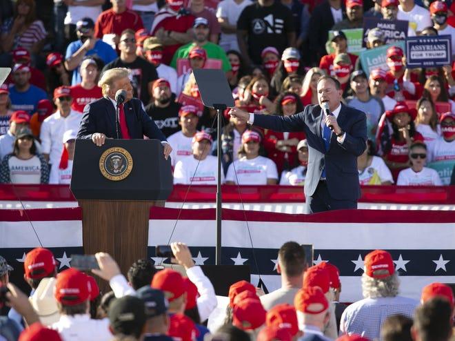 U.S. Senator Mike Lee, R-Utah, speaks as President Donald Trump looks on during a rally at Phoenix Goodyear Airport in Goodyear, Ariz., on Oct. 28, 2020.