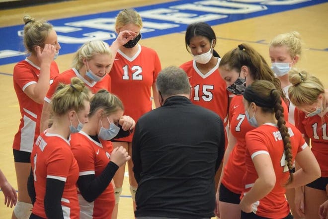 Port Huron coach Derek Arena talks with his players during a Macomb Area Conference-Blue volleyball game on Tuesday, Oct. 27, 2020, at L'Anse Creuse.