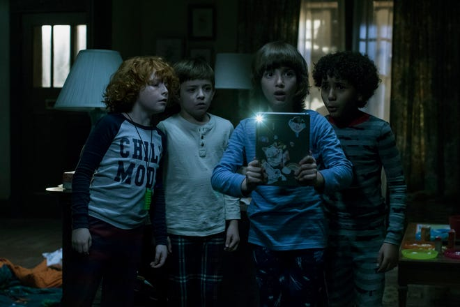 """From left, Gavin Maciver-Wright, Winslow Fegley, Azhy Robertson and Jayden Marine star in """"Come Play."""" The movie is playing at Queensgate Movies 13 and Hanover Movies 16."""