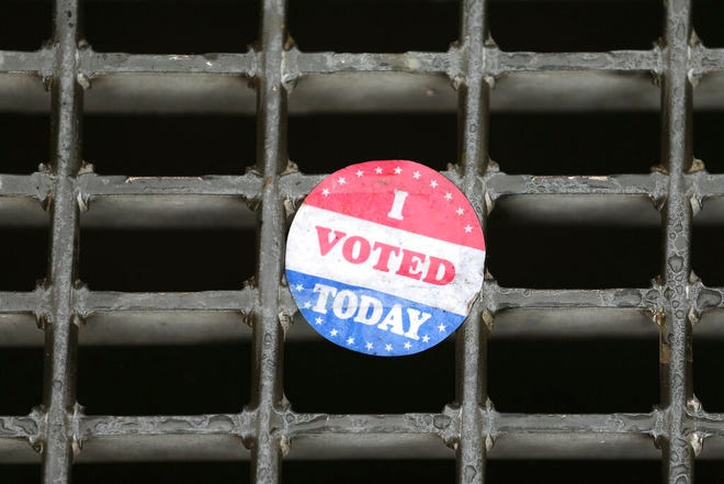 "An ""I voted today"" sticker rests on a subway grate outside the early voting location at the Liacouras Center in Philadelphia, Pa. on October 26, 2020. (David Maialetti/The Philadelphia Inquirer via AP)"