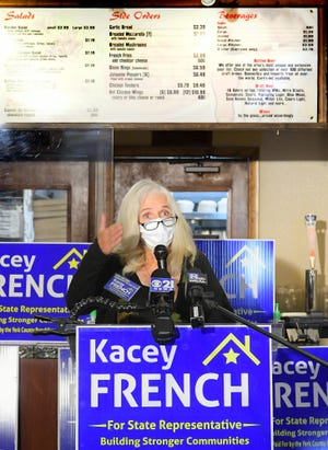 Kacey French, 95th House District candidate, speaks during a press conference at the recently-closed Vito's Pizza and Beer Thursday, Oct. 29, 2020. The speakers called for easing of restrictions imposed on eateries due to the COVID-19 pandemic. Bill Kalina photo