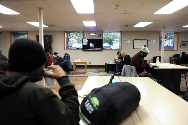 People who are experiencing homelessness gather in the dayroom at ARCHES Project in Salem on Thursday, Oct. 29, 2020. The non-profit organization is expanding the time that people have access to the dayroom area.