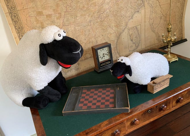 "Woolly and Wee Woolly play a game in the Woodrow Wilson Presidential Library and Museum as part of the video series, ""Sheep on the Loose."""
