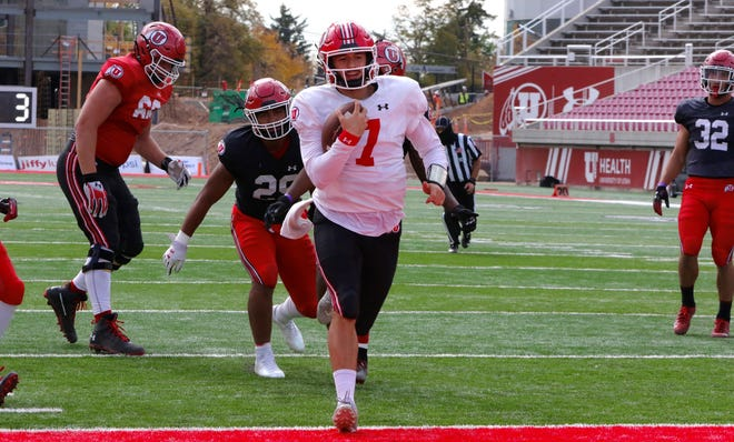 Cameron Rising runs into the end zone during a Utah practice.