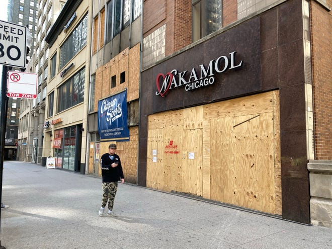 Dozens of businesses in downtown Chicago are boarded up on Oct. 14, 2020. Many have been boarded up since incidents of looting earlier in the summer.