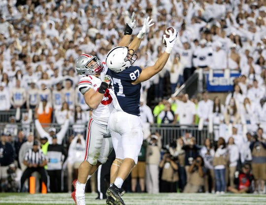 Penn State tight end Pat Freiermuth (87) catches a pass in the end zone for a touchdown during the fourth quarter against Ohio State at Beaver Stadium in 2018.