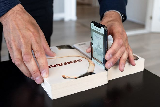 Placing a phone between two books to act as a stand.