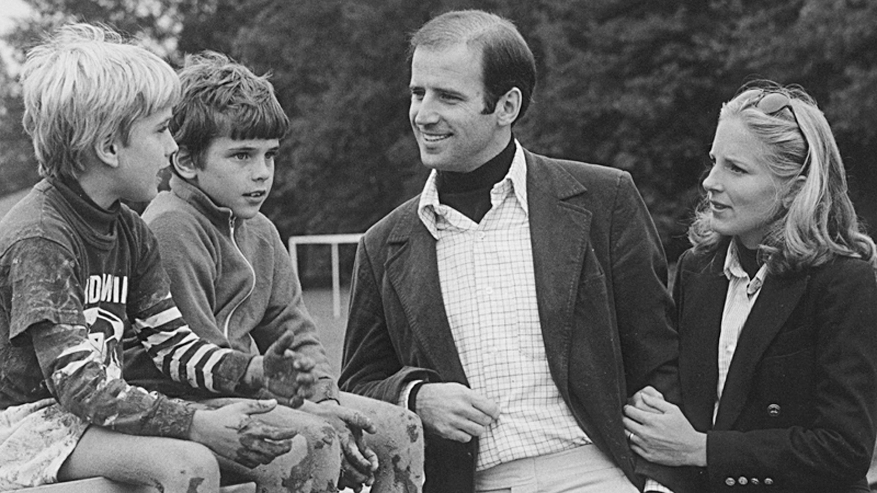 This image obtained from the official website of US Senator Joseph Biden shows him with his sons Beau, left,  and Hunter, and his future wife Jill in an undated photo.
