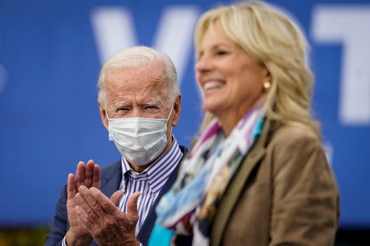 Then-Democratic presidential nominee Joe Biden listens as his wife Jill Biden speaks during a drive-in campaign rally at Bucks County Community College on Oct. 24, 2020 in Bristol, Pa. During his address to a joint session of Congress on April 28, the president announced that his wife would run point on education proposals, including free community college tuition for two years.