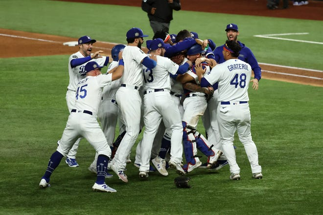 The Los Angeles Dodgers celebrate winning the World Series against the Tampa Bay Rays.