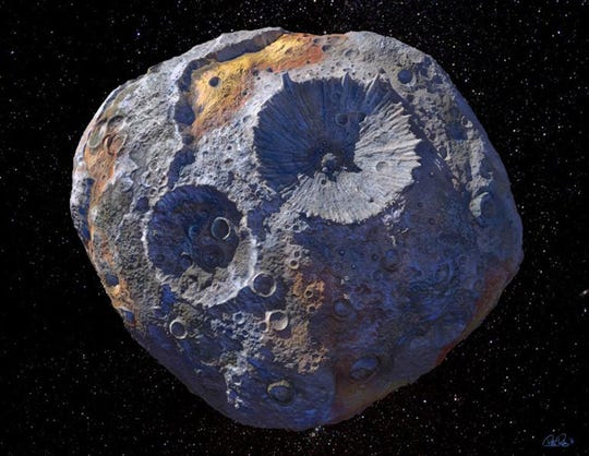 An artist's view of the 16 Psyche asteroid, one of the largest objects in the main asteroid belt orbit between Mars and Jupiter.  According to a new study published this week, the asteroid could be made entirely of metal.