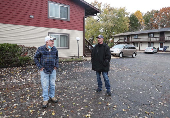Chuck Fowler, left, the owner of Barber View Apartment Rentals, and Chris Hudkins, the manager, at the apartments in Barberton. Fowler had been trying to evict a renter who is a convicted rapist but initially was unable because of a federal moratorium on evictions during the COVID-19 pandemic.