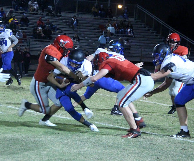Dickson quarterback Jack McDonald is brought down by a pair of Pauls Valley defenders on Thursday night. The Comets lost 41-6.