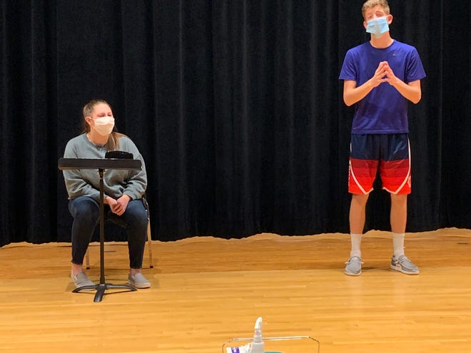 """Lori Oakland rehearses the role of Mica and Sam Skaar the role of Google, two of the main characters in Roland-Story's fall play, """"The Internet is Distract—Oh Look a Kitten."""" Students have been rehearsing while observing COVID-19 protocols."""