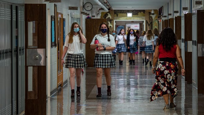 Students at the private Villa Joseph Marie High School in Northampton change classes earlier this year. Since opening Sept. 8, the school has had only one COVID-19 case traced back to a source outside the school.