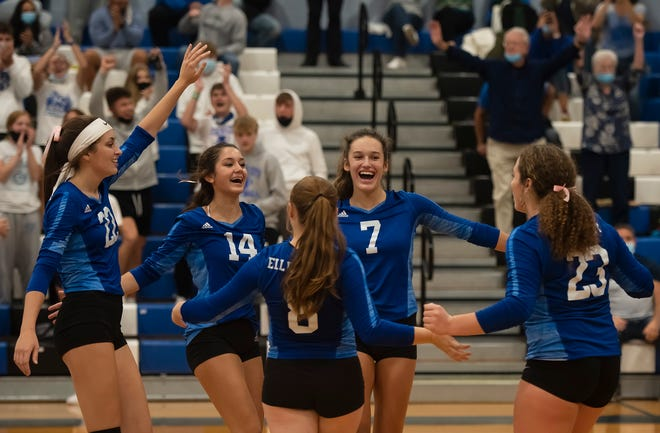 The Ellwood City girls volleyball team celebrates its 3-0 playoff win over Ligonier Valley on Thursday at Lincoln High School.