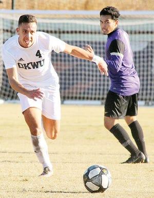 Ognjen Stevic, left, of the Oklahoma Wesleyan University men's soccer team hustles after the ball.