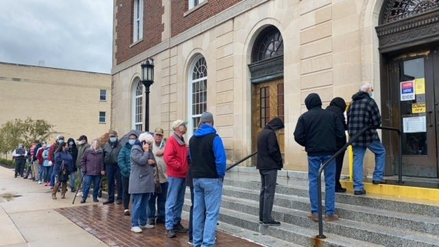 Washington County residents wait in line for early voting Thursday. County voter turnout is on track to break records.