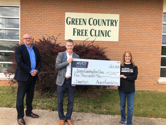 Arvest loan manager David Nickel and Arvest Wealth Management Trust Officer Kevin Hay present a contribution to Cindy Pribil, RN director of Green Country Free Clinic.