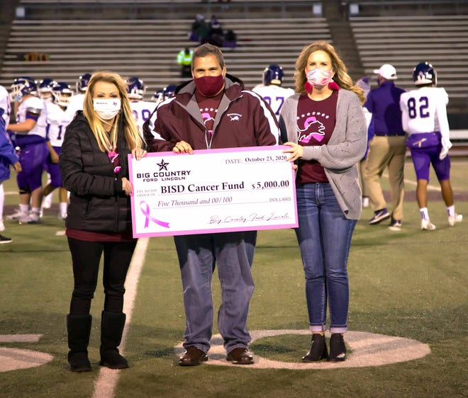 From left, Big Country Ford Lincoln Owner, Diane Winn, BISD Superintendent Dr. Joe Young, and Big Country Ford Lincoln Office Manager Jennifer Perkins are pictured with the oversized check.