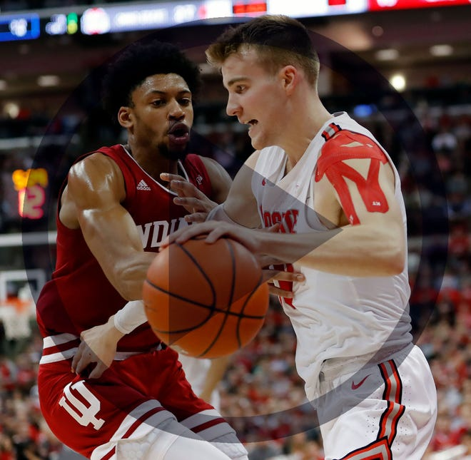 Ohio State Buckeyes forward Justin Ahrens (10) dribbles around Indiana Hoosiers forward Jerome Hunter (21) during the first half of the NCAA men's basketball game at Value City Arena in Columbus on Saturday, Feb. 1, 2020.
