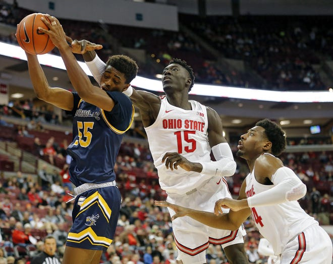 Ohio State Buckeyes center Ibrahima Diallo (15) blocks the shot of Cedarville guard Quinton Green (55) during the 2nd half of their game at Value City Arena in Columbus, Ohio on October 30, 2019. [Kyle Robertson]