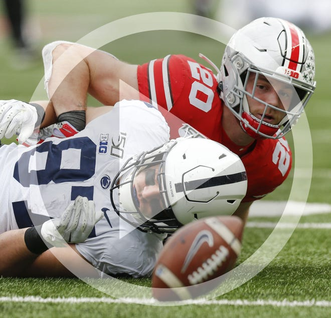 In this file photo, Ohio State Buckeyes linebacker Pete Werner (20) watches as the ball falls to the ground after helping break up a pass intended for Penn State Nittany Lions tight end Pat Freiermuth (87) during the second quarter of a NCAA Division I college football game between the Ohio State Buckeyes and the Penn State Nittany Lions on Saturday, November 23, 2019 at Ohio Stadium in Columbus, Ohio.