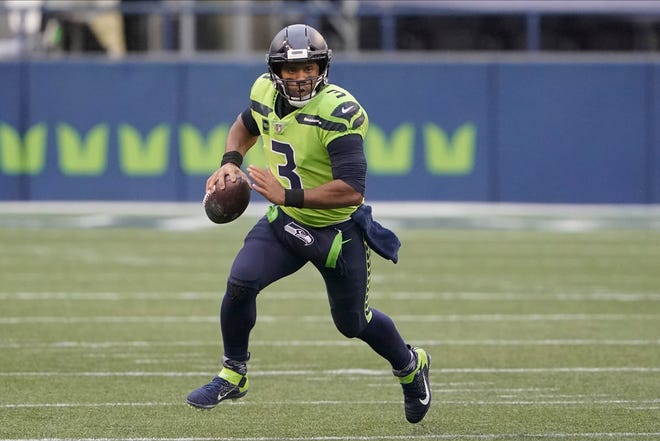 Seattle Seahawks quarterback Russell Wilson and his Grammy-winning wife, pop singer Ciara, are putting their money and celebrity behind rebranding a charter school. [Ted S. Warren/AP File]