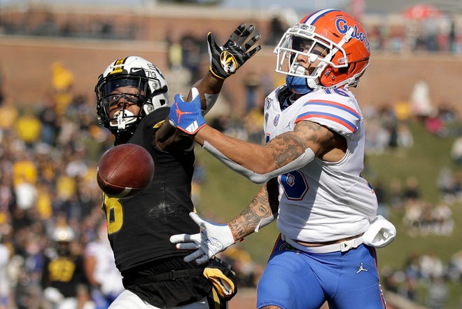 Missouri safety Joshuah Bledsoe, left, defends a pass against Florida during a game Nov. 16, 2019, at Faurot Field.