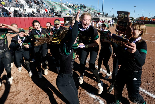 The Rock Bridge softball team celebrates after it beat Lee's Summit North in the Class 5 state championship Friday at Killian Sports Complex in Springfield.