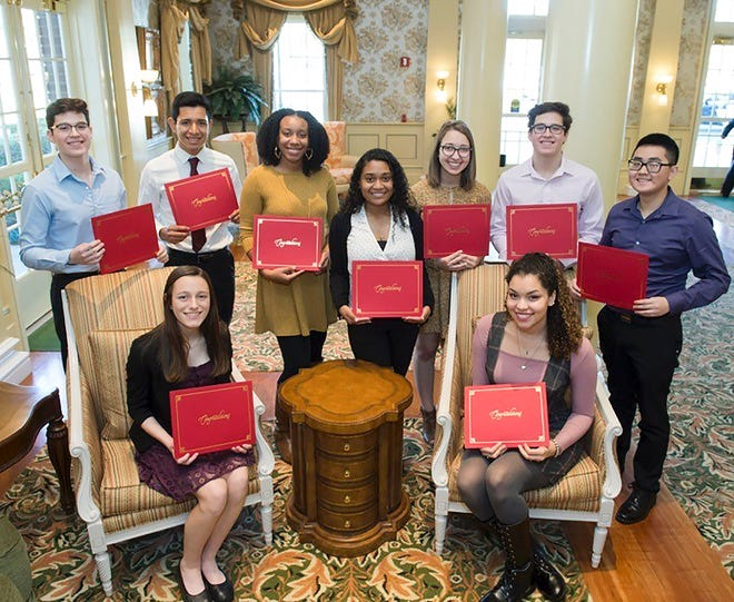 The 2018-2019 MLK Scholarship award winners receive their certificates in January 2019. The committee is currently taking applications for the 2020-2021 seniors.