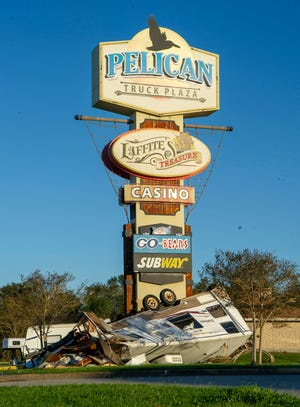 A camper toppled by Hurricane Zeta is shown Thursday at the Pelican Truck Plaza in Golden Meadow.