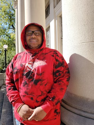 Josh Gilmore of Lexington has launched a new clothing line called Star Power. He sports one of the endless designs and styles of hoodies his company offers while standing on the steps of the former Davidson County Arts United Building on Main Street.