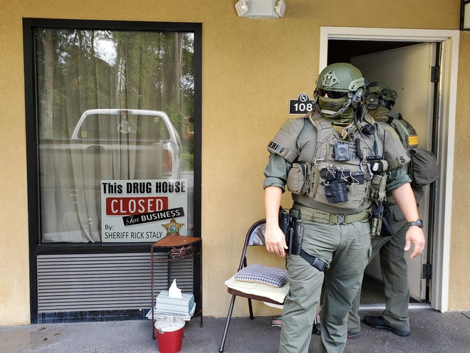 A Flagler County Sheriff's deputy outside the motel room where Joshua LeMaster was arrested on Thursday.