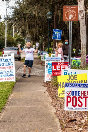 County Council race campaigners at the Ormond Beach early voting station.