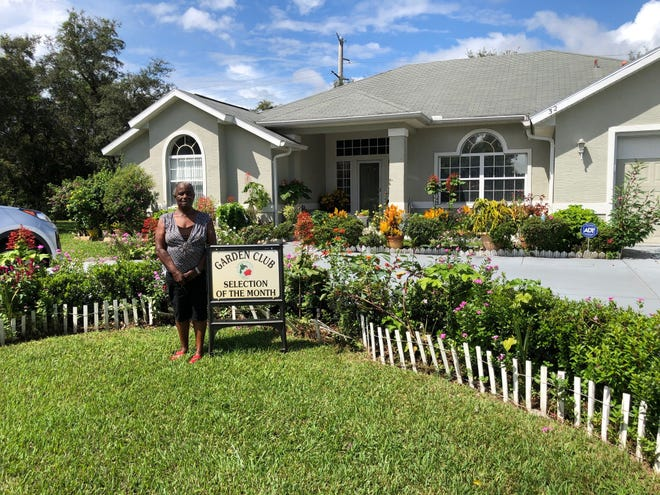Norma Rose stands in front of the colorful garden at her Ferndale Lane home.