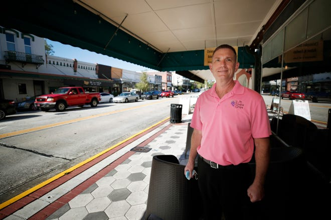 Bill Budzinski, the owner of The Elusive Grape, was named DeLand Volunteer of the Year.