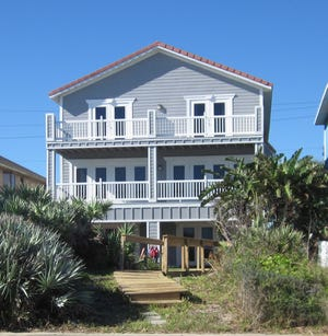 This beachside home on South Oceanshore Boulevard in Flagler Beach has five bedrooms and five baths in 3,680 square feet of living space, and sold recently for $1,050,000. Built in 1999, it also has a fireplace, a wet bar, a walk-in pantry, four balconies, a patio and a private beach walkover.