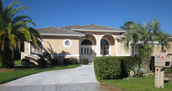 Built in 1999 in the Palm Harbor neighborhood, this house on Flemingwood Lane has three bedrooms and three baths in 2,154 square feet of living space. It also has a gas fireplace, a heated screened pool, fruit trees, a summer kitchen, a backyard storage building and a circular drive. It sold recently for $315,000.