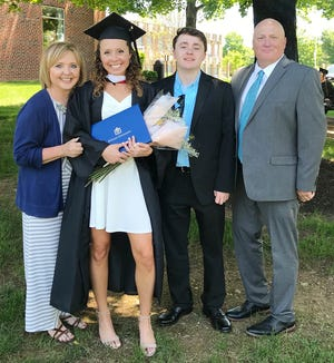 Former Lady Hornet hoops star Morgan Birmelin is all smiles on graduation day at DeSales University. She is pictured here with her family: Mom Kelly, brother Grady, and Dad Mike.